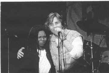Whoopi with Don Mclean (I think)